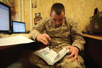 Cpl. Chad Tucker, a financial management resource analyst with Marine Expeditionary Brigade–Afghanistan, studies at the end of his day here, Feb. 20. Like Tucker, many Marines have taken advantage of online education while deployed.