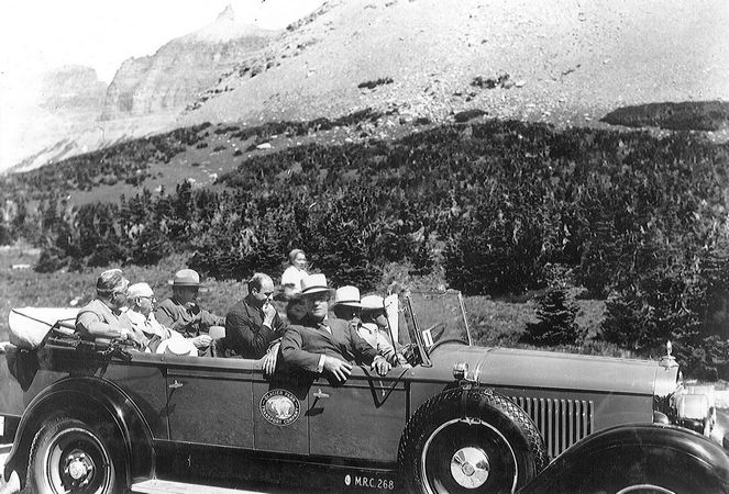 Former President Franklin Delano Roosevelt, facing camera, is seen in his 1927 Cadillac during a trip to Montana in 1937. FDR made two trips to Montana, to inspect the Going to the Sun Highway in Glacier Park and view Fort Peck Dam. Dale Duff of Whitefish, Mont., purchased the car in 2000, and it is still in mint condition.