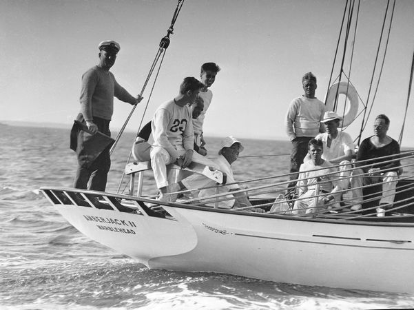 The 45-foot schooner Amberjack, with President Franklin D. Roosevelt aboard, seated and wearing a sailor's hat, is shown sailing from Buzzard's Bay, Mass., toward Campobello Island, off the coast of Maine, during his vacation, June 1933.