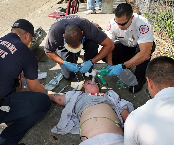 Members of the Miami Fire Rescue work on a man suspected of a heroin/fentanyl overdose.