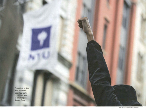 Student with fist in air