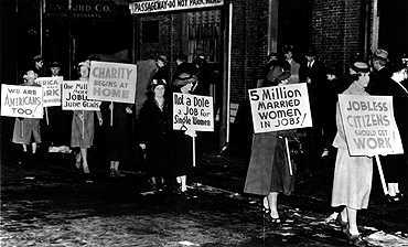 Protestors from the Womens Political Club of Boston picket against the employment of married women in public service jobs.  Corbis-Bettmann.