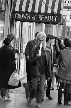 A typical hippie girl walking down Haight Street in San Francisco, California.  Corbis-Bettmann.