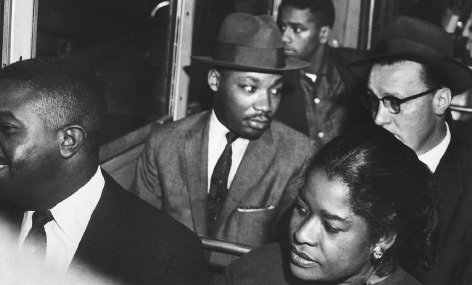 Martin Luther King, leader of a boycott against a segregated transit system, rides a Montgomery, Alabama, bus, 1956. Sitting beside him is Rev. Glenn Smiley.  BETTMANNCORBIS. REPRODUCED BY PERMISSION.