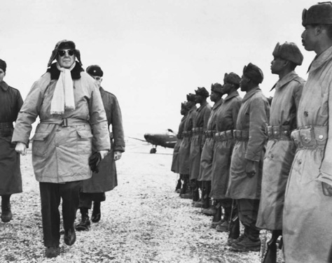 Douglas MacArthur inspecting African American troops at Kimpo airfield, 1951, during the Korean War.