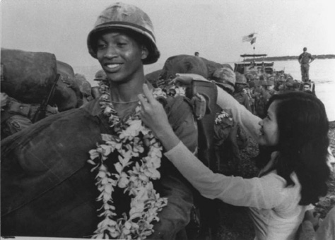 An African American member of the 25th Infantry Division is greeted in 1966 by the Vietnamese.