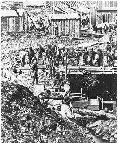 Miners in Deadwood, Dakota Territory, c. 1876. Gold was discovered near Deadwood Gulch in 1874. As with other sites in the West, the discovery quickly created the kind of exploitative community described by Bret Harte, Mark Twain, and other wes