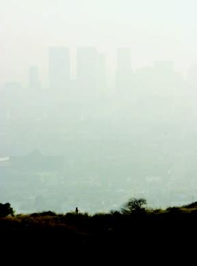 Smog shrouds the skyline of the city of Los Angeles in a view from the Hollywood Hills. The city is famous for pollution.