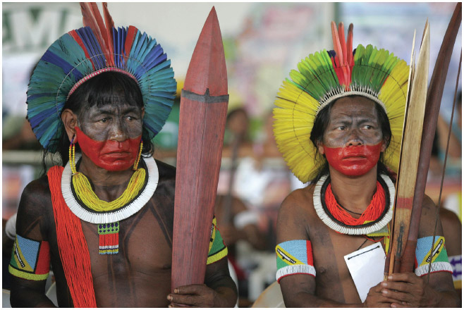 Native peoples are often disproportionately affected when lands are flooded due to the construction of hydroelectric dams. Here, indigenous men attend a protest in 2008 against the construction of a dam in Brazil. Many protesters voiced concern
