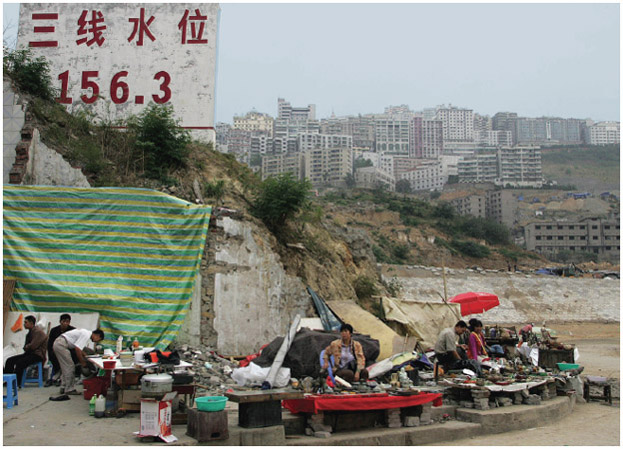Before the Three Gorges Dam began operation, the Chinese government posted signs noting where the new water level would be. In the Chongqing municipality, the water level was expected to rise to the 156.3 -meter (512.8-foot) mark. It is estimat