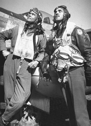 Among the African Americans who served in World War II were the Tuskegee Airmen. Here, Col. Benjamin O. Davis Jr. (left) and 1st Lt. Lee Rayford (right) discuss strategies.