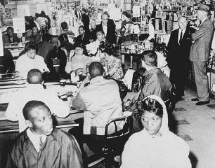 After the Greensboro sit-in, students staged similar protests in other cities in the South. Here, activists sit at a Woolworths lunch counter in Atlanta, Georgia, waiting to be served.