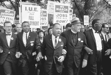 During the March on Washington for Jobs and Freedom in August 1963, civil rights leader Martin Luther King Jr. (center) is joined by (l-r) Rabbi Joachim Prinz, Eugene Carson Blake, Floyd McKissick, and Matthew Ahmann, among others.