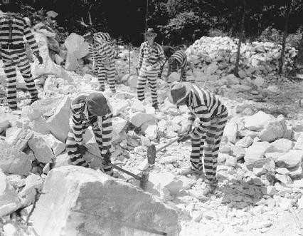 Although prison labor was stopped in many facilities, it continued in others. Here, convicts perform hard labor in a Georgia chain gang camp in 1937.