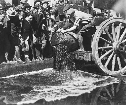 In October of 1920, federal agents dump barrels of wine into the gutter on a busy Los Angeles street as onlookers crowd the sidewalk. For a time, the street was red with wine.