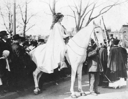 Lawyer Inez Boissevain, dressed in white and on horseback, led the National American Woman Suffrage Association parade through the streets of Washington, D.C., in 1913. Many of the marchers endured insults, grabbing, pinching, and spitting by s