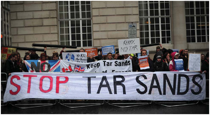 Protesters take part in a rally in central London on April 11, 2013, to demonstrate against the Keystone XL Tar Sands Pipeline as foreign ministers from the G8 group of nations meet nearby.