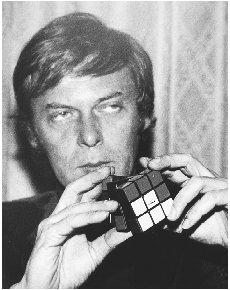 Erno Rubik demonstrates how to use Rubik's Cube. Photograph by John Glanville. AP/Wide World Photos. Reproduced by permission.