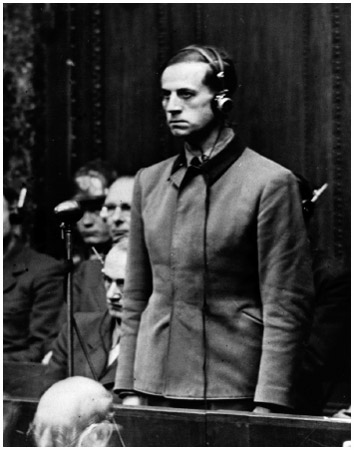 One of the principle defendants of the Nuremberg Trials, Karl Brandt, was the personal doctor of Adolf Hitler. He listens to the proclamation of his verdict at the Doctors Trial.