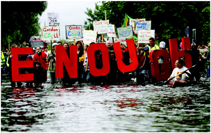 In 2007, regions in the United Kingdom were hit by severe floods. Claiming that anthropogenic climate change was to blame for the flooding, protesters in Oxford, U.K., held a demonstration demanding change. AP Images.