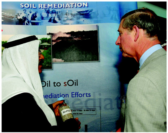 Prince Charles (right) and Dr. Nader Al Awadhi of the Kuwait Institute for Scientific Research discuss the effects of climate change and ways to reduce carbon emissions. Prince Charles invests in tree planting