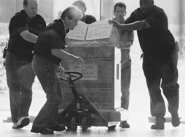 Crew Moving Ten Commandments Monument