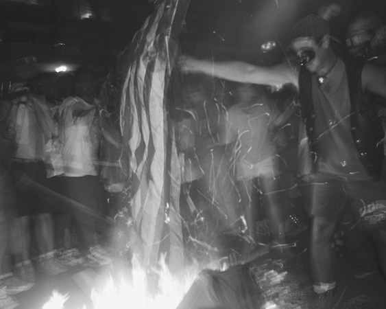 Protesters Burning U.S. Flag