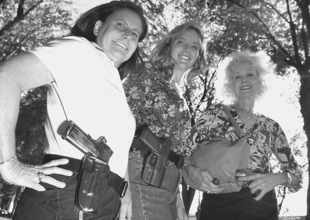 Women Posing With Guns