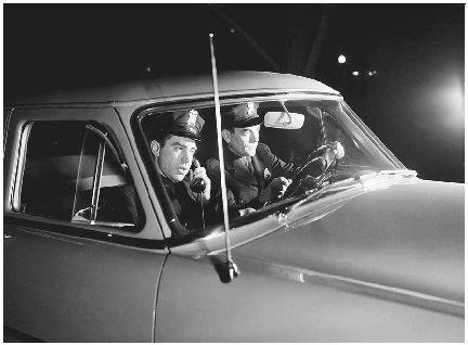 Policing was revolutionized with the widespread use of police cars and two-way radios. ( H. Armstrong Roberts/Corbis)