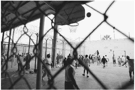 Death row inmates, or those who have been sentenced to death and are awaiting execution, play basketball in San Quentin Prison. (AP/Wide World Photos)