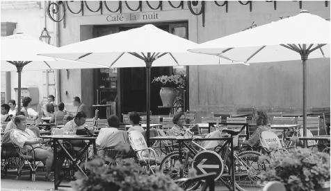 People at an outdoor caf in France. Cafs are social centers for men in southern France and are also popular among tourists.