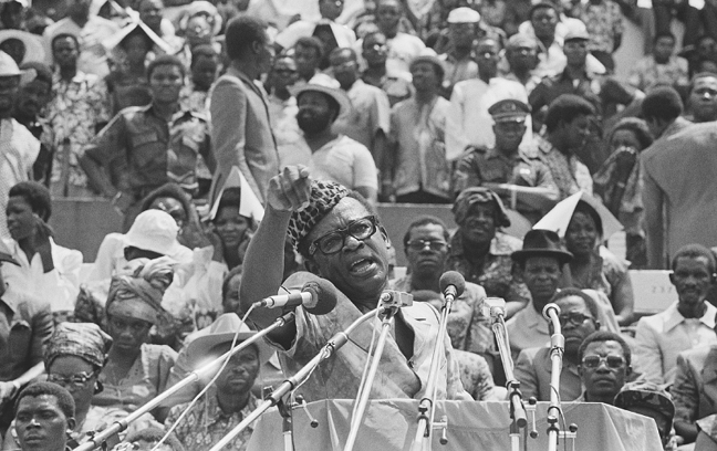 Zairian president Mobutu Sese Seko at Kinshasa Stadium presents to a crowd of 60,000 people the first wounded revolutionist prisoners captured