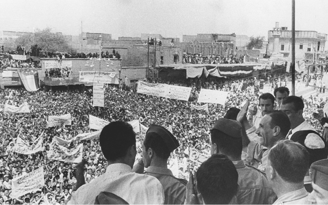 Vice Premier Abd al-Salam Arif addresses a crowd in An Najaf, Iraq, explaining the objectives and reforms of the new government on 9 August 1958. Colonel Arif and General Abd al-Karim Qasim overthrew the ruling monarchy in a coup