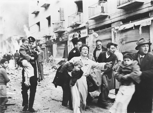 A mother flees with her family from a destroyed block of buildings in the Jewish section of Jerusalem during the Israeli War for Independence in 1948. (Library of Congress)