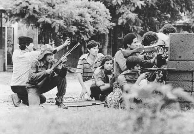 Young Sandinista guerrillas man a position in Masaya, Nicaragua, on 25 July 1979. The boy at left is armed with a slingshot. (BettmannCorbis)