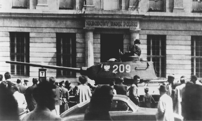 A tank surrounded by civilians in front of a bank during antigovernment rioting in Pozna, Poland, in 1956. (Library of Congress)