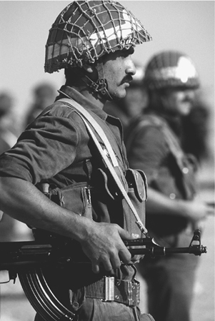 A member of a Syrian honor guard stands at attention during Operation DESERT SHIELD. Despite Syrian animosity toward U.S. ally Israel, Syria joined the United States in the coalition against Iraq during the Persian Gulf War of 1991. (U.S. Depar