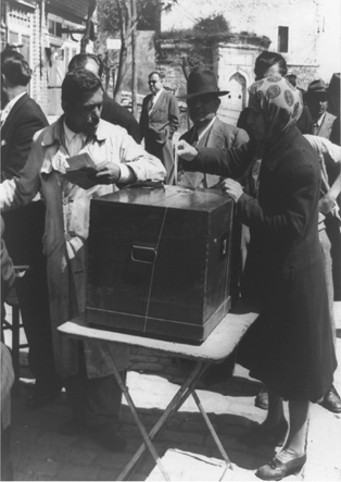 Voter placing ballot in box during voting in Istanbul, Turkey, 1950. Following the legalization of multiple political parties in 1946, the Democratic Party, which promoted political and economic liberalism, quickly rose to power and