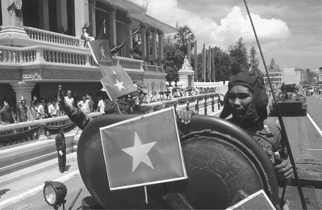 Official ceremony in front of the Presidential Palace in Phnom Penh during the withdrawal of the Vietnamese occupation troops, 25 September 1989. (Jacques LangevinCorbis Sygma)