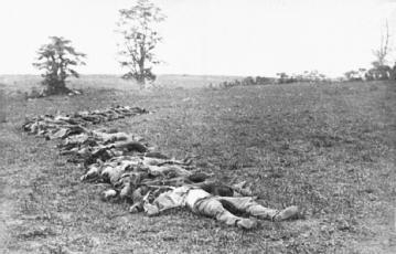 Aftermath of Antietam. Until long afterward, Alexander Gardner (and his associates) received little personal recognition for unprecedented stark battlefield photographs like this one of dead Confederates collected for burial. Initial credit went to his famous employer in New York, Mathew Brady—who took few photographs of the war himself. LIBRARY OF CONGRESS