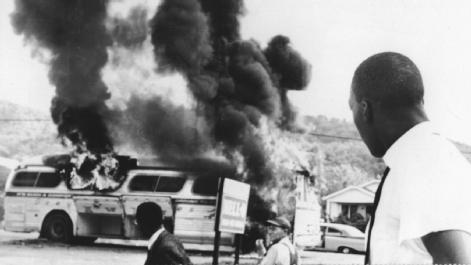 Violent Response. The first Freedom Riders manage to escape their burning bus outside Anniston, Ala., a Ku Klux Klan stronghold, after a mob shot out its tires, smashed its windows, and threw an incendiary device into it on 14 May 1961. AP/WIDE WORLD PHOTOS