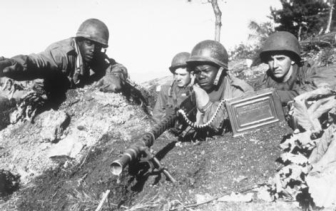 On the Defensive. Members of the U.S. Army's Second Infantry Division man a machine gun in a foxhole, 1950.
