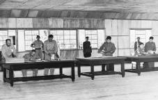 Ending the Fighting. Lieutenant General William K. Harrison (seated at left) and General Nam Il, spokesman for the Communist delegation (seated at right), sign multiple copies of the armistice at Panmunjom, just below the thirty-eighth parallel, on 27 July 1953. ARCHIVE PHOTOS, INC.
