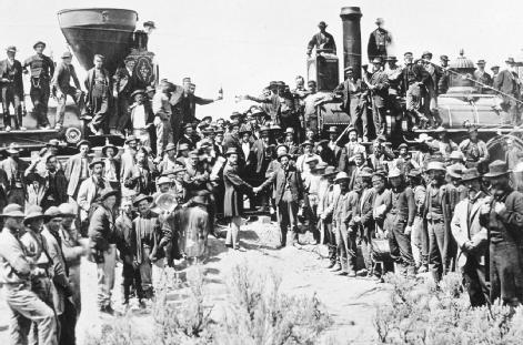Golden Spike Ceremony. Men and engines of the Union Pacific and Central Pacific Railroads, approaching from opposite directions, meet face-to-face as the first transcontinental railroad is completed just north of the Great Salt Lake in Utah, 10 May 1869. GETTY IMAGES