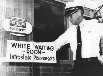 White Waiting Room. The police chief of McComb, Miss., looks at a sign aimed at passengers within the state, posted at the town's Greyhound Bus Depot, in 1961. AP/WIDE WORLD PHOTOS