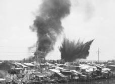 Tet Offensive. The Cholon area of Saigon is hit by two 750-pound bombs during the shelling of the South Vietnamese capital in early 1968. © CORBIS