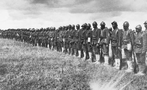 African American Troops. Members of the all-black Fifteenth New York Infantry Regiment (commanded by white officers) stand at attention in France in 1918. Redesignated the 369th Infantry, the regiment served in combat with the French army.  © CORBIS