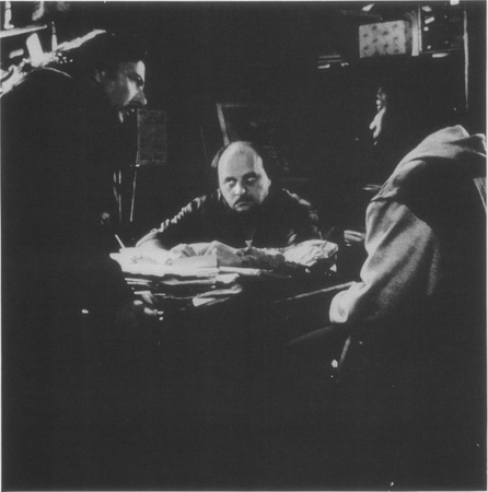 Teach (Dustin Hoffman) and Don (Dennis Franz) confront Bob (Sean Nelson) about his buffalo nickel in a scene from the 1996 film adaptation, which was scripted by Mamet