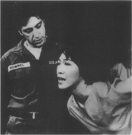 Pavlo with Yen (Tisa Chang) in the brothel where he will meet his doom