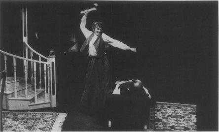 A scene from the 1997 Guild Hall production of Pollocks play. The Actress (Mary Sloane) playing the part of Lizzie, takes an ax to Mr. Borden (Mike Curtis)
